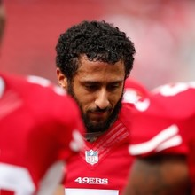 Colin Kaepernick Sits For National Anthem
